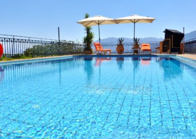 2-Orange-Sunloungers-over-pool1
