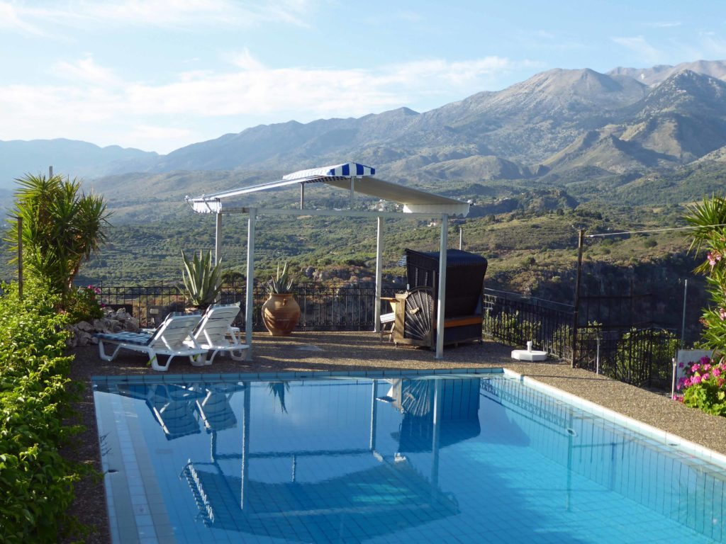 Recharge your batteries at Panokosmos, lounge by the pool with great views of the mountains