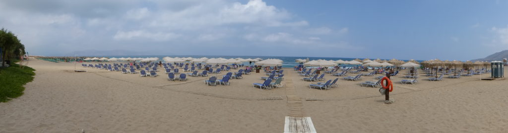 Ranked mass of sunbeds waiting for the crowds