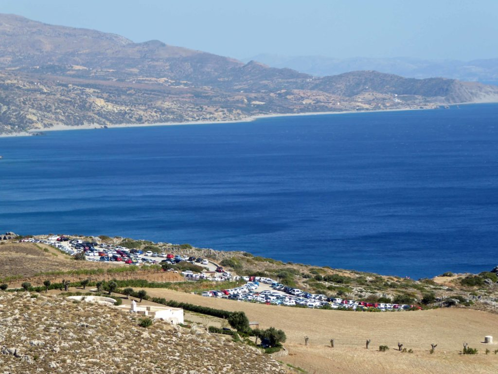 Car park high above Preveli Beach - taverna just visible above it
